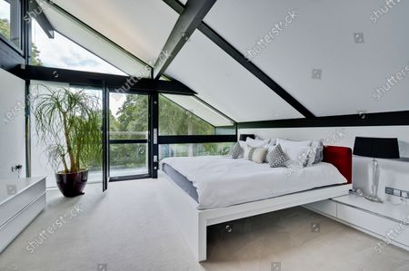 Bedroom.   The UK home of Hollywood actor Antonio Banderas is on the market for £2.95m.  The Mask of Zorro star moved from LA to Cobham in Surrey in 2015 with girlfriend Nicole Kimpel after splitting from his wife of 20 years Melanie Griffiths.  They are now selling their home to spend more time in Banderas' native Malaga, where he has bought and built a theatre.