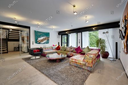 Stock Image of Lounge.   The UK home of Hollywood actor Antonio Banderas is on the market for £2.95m.  The Mask of Zorro star moved from LA to Cobham in Surrey in 2015 with girlfriend Nicole Kimpel after splitting from his wife of 20 years Melanie Griffiths.  They are now selling their home to spend more time in Banderas' native Malaga, where he has bought and built a theatre.