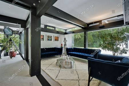 Stock Photo of Living area.   The UK home of Hollywood actor Antonio Banderas is on the market for £2.95m.  The Mask of Zorro star moved from LA to Cobham in Surrey in 2015 with girlfriend Nicole Kimpel after splitting from his wife of 20 years Melanie Griffiths.  They are now selling their home to spend more time in Banderas' native Malaga, where he has bought and built a theatre.
