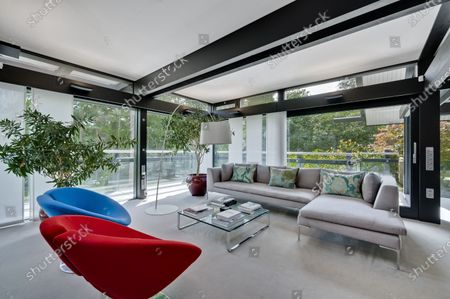 Living room.   The UK home of Hollywood actor Antonio Banderas is on the market for £2.95m.  The Mask of Zorro star moved from LA to Cobham in Surrey in 2015 with girlfriend Nicole Kimpel after splitting from his wife of 20 years Melanie Griffiths.  They are now selling their home to spend more time in Banderas' native Malaga, where he has bought and built a theatre.