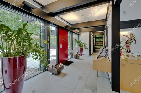 Entrance hall.   The UK home of Hollywood actor Antonio Banderas is on the market for £2.95m.  The Mask of Zorro star moved from LA to Cobham in Surrey in 2015 with girlfriend Nicole Kimpel after splitting from his wife of 20 years Melanie Griffiths.  They are now selling their home to spend more time in Banderas' native Malaga, where he has bought and built a theatre.