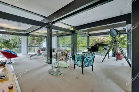 Living space.   The UK home of Hollywood actor Antonio Banderas is on the market for £2.95m.  The Mask of Zorro star moved from LA to Cobham in Surrey in 2015 with girlfriend Nicole Kimpel after splitting from his wife of 20 years Melanie Griffiths.  They are now selling their home to spend more time in Banderas' native Malaga, where he has bought and built a theatre.