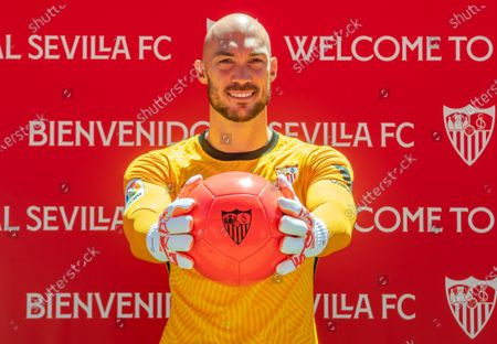 Serbian goalkeeper Marko Dmitrovic poses during his presentation as new player of Sevilla FC in Seville, Andalusia, Spain, 05 July 2021. Dmitrovic, who comes from UD Eibar, has signed until 2025.