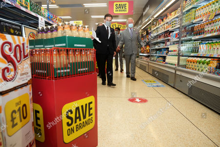 Prince Charles is given a shopfloor tour by Richard Walker Managing Director of Iceland during a visit to Iceland Foods Ltd on July 5, 2021 in Deeside, Wales.
