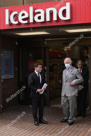 Prince Charles is given a tour by Richard Walker (L) Managing Director of Iceland and Sir Malcolm Walker (R), Founder & Executive Chairman of Iceland during a visit to Iceland Foods Ltd on July 5, 2021 in Deeside, Wales.