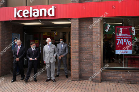 Prince Charles is given a tour by Richard Walker (2nd L), Managing Director of Iceland and Sir Malcolm Walker (L), Founder & Executive Chairman of Iceland during a visit to Iceland Foods Ltd on July 5, 2021 in Deeside, Wales.