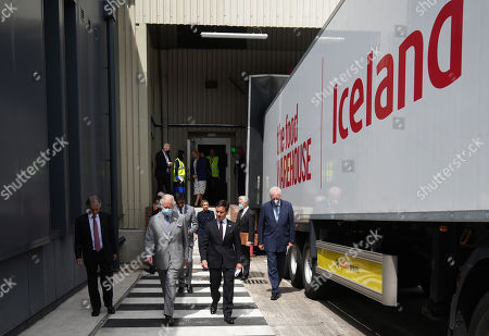 Prince Charles is given a tour by Richard Walker (R), Managing Director of Iceland and Sir Malcolm Walker (L), Founder & Executive Chairman of Iceland during a visit to Iceland Foods Ltd on July 5, 2021 in Deeside, Wales.