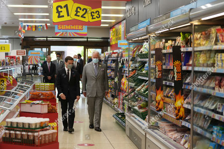 Prince Charles is given a shopfloor tour by Richard Walker, Managing Director of Iceland during a visit to Iceland Foods Ltd on July 5, 2021 in Deeside, Wales.