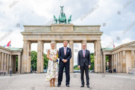 King Willem-Alexander and Queen Maxima of the Netherlands with Mayor of Berlin Michael Muller at Brandenburger Tor, Berlin, on the first of the 3 day state visit of the Dutch Royals to Germany.