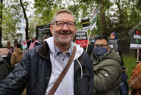 Union boss, Len McCluskey seen during the demonstration. Thousands of Pro Palestinian demonstrators rally on the Embankment before marching across central London to Hyde Park. They call for an end to Israel's policy of discrimination against Palestinians, a free Palestine and an end to illegal occupation of Gaza.