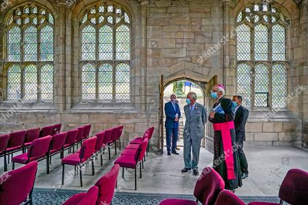 Stock Image of Prince Charles (second left) is welcomed by Lord-Lieutenant of Clwyd, Henry Fetherstonhaugh (left), Bishop of Wrexham Peter Brignall (second right) and Roman Catholic parish Priest for Holywell, Father Justin Karakadu (right), during a visit to St Winefride's Well, Flintshire, north Wales, a popular Catholic pilgrimage site, as part of a week long tour of Wales for Wales Week.
