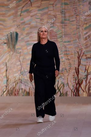 Italian designer Maria Grazia Chiuri takes to the catwalk after presenting her Fall/Winter 2021/2022 Haute Couture collection for Dior fashion house during the Paris Fashion Week in Paris, France, 05 July 2021. The presentation of the Haute Couture collections runs from 05 to 08 July.