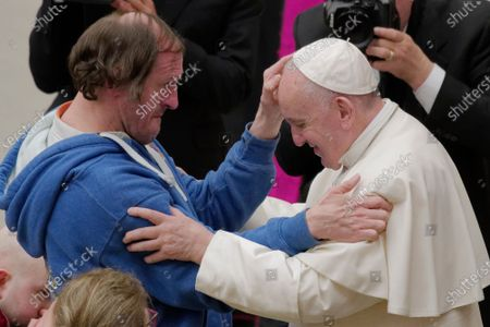 Pope Francis is blesses  by a man during his weekly general audience, at the Pope Paul VI hall, at the Vatican, Wednesday, Feb. 19, 2020.