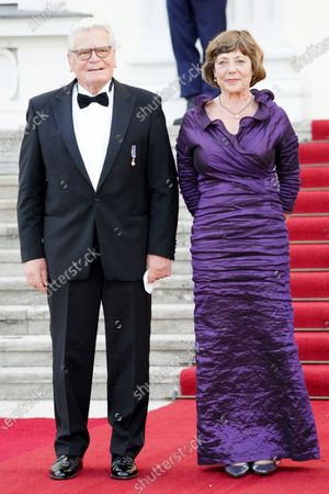 Stock Image of Former German President Joachim Gauck (L) and his partner Daniela Schadt arrive at Bellevue Palace on the occasion of a state banquet in honor of the Dutch King and Queen in Berlin, Germany, 05 July 2021. The Dutch royal couple is on a three-day visit to Berlin.