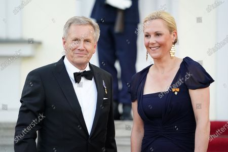 Former German President Christian Wulff (L) and his wife Bettina arrive at Bellevue Palace on the occasion of a state banquet in honor of the Dutch King and Queen in Berlin, Germany, 05 July 2021. The Dutch royal couple is on a three-day visit to Berlin.