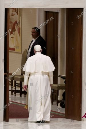 Pope Francis leaves at the end of his weekly general audience in the Pope Paul VI hall at the Vatican, Wednesday, Oct. 14, 2020.
