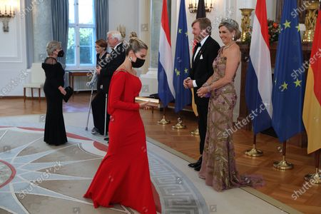 Stock Photo of King Willem-Alexander (2-R) and Queen Maxima (R) of the Netherlands, next to German German President Frank-Walter Steinmeier (3-L) and his wife Elke Buedenbender (2-L), greet Dutch television personality and model Sylvie Meis (C) during a state banquet in honor of the Dutch royal coupleat Bellevue Palace in Berlin, Germany, 05 July 2021. The Dutch royal couple is on a three-day visit to Berlin.