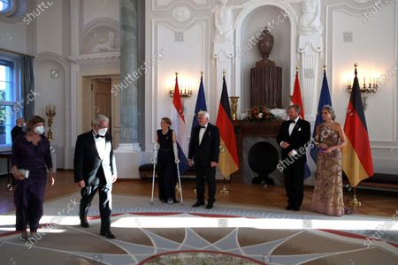 King Willem-Alexander (2-R) and Queen Maxima (R) of the Netherlands with German German President Frank-Walter Steinmeier (3-R) and his wife Elke Buedenbender (4-R) greet former German President Joachim Gauck (2-L) and his partner Daniela Schadt (L) during a state banquet in honor of the Dutch royal coupleat Bellevue Palace in Berlin, Germany, 05 July 2021. The Dutch royal couple is on a three-day visit to Berlin.