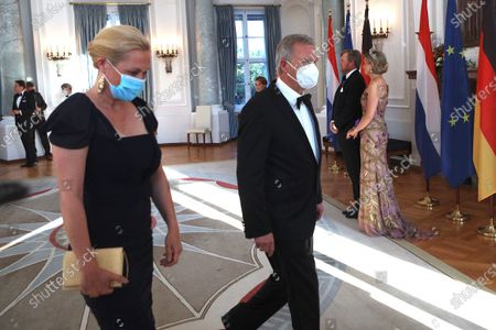 Stock Image of Former German President Christian Wulff (2-L) and his wife Bettina (L) walk past King Willem-Alexander (2-R) and Queen Maxima (R) of the Netherlands during a state banquet in honor of the Dutch royal couple at Bellevue Palace in Berlin, Germany, 05 July 2021. The Dutch royal couple is on a three-day visit to Berlin.
