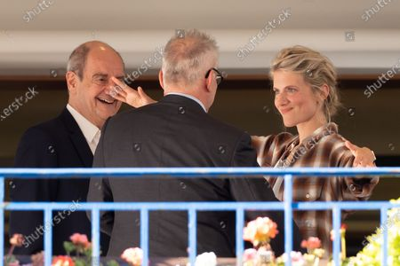 Pierre Lescure, Thierry Fremaux and Melanie Laurent await the jury dinner ahead of the 74th annual Cannes Film Festival at the Hotel Martinez