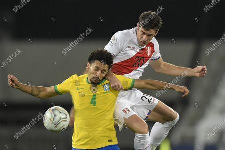 Marquinhos of Brazil and Santiago Ormeño of Peru; Nilton Santos Stadium, Rio de Janeiro, Brazil; Copa America, Brazil versus Peru.