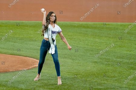 Stock Picture of Paige Vasquez, Miss Texas, throws out the ceremonial first pitch before a baseball game between the Detroit Tigers and the Texas Rangers in Arlington, Texas