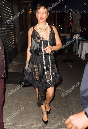 Rihanna wears a see-through dress and long pearl necklace as she dines at Carbone