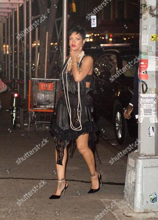 Stock Picture of Rihanna wears a see-through dress and long pearl necklace as she dines at Carbone