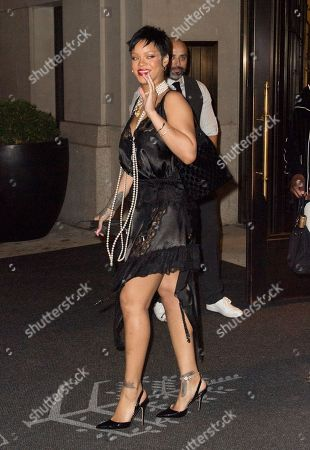 Stock Image of Rihanna wears a see-through dress and long pearl necklace as she dines at Carbone