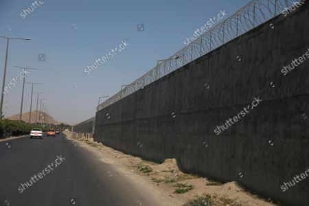 Blast wall protects Hamid Karzai International Airport in Kabul, Afghanistan, . Long before the last U.S. and NATO troops packed up to leave Afghanistan, American diplomats arriving in the capital Kabul were taken to the heavily fortified U.S. Embassy by helicopter. The short four- mile road trip through Kabul's chaotic traffic was considered too dangerous