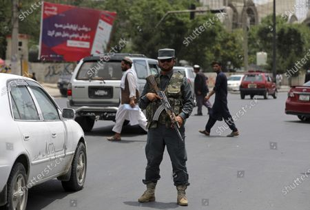 An Afghan policeman stands guard at a checkpoint in Kabul, Afghanistan, . Long before the last U.S. and NATO troops packed up to leave Afghanistan, American diplomats arriving in the capital Kabul were taken to the heavily fortified U.S. Embassy by helicopter. The short four- mile road trip through Kabul's chaotic traffic was considered too dangerous