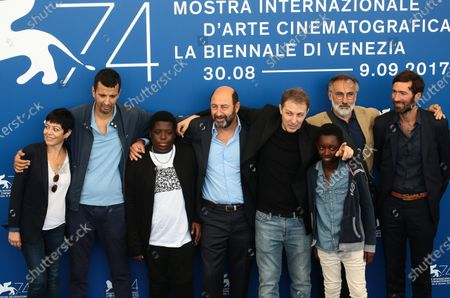 Valerie Zenatti, Samir Guesmi, Youssouf Gueye, Kad Merad, Director Rachid Hami, Renely Alfred and guests attend 'La Melodie' photocall during the 74th Venice Film Festival