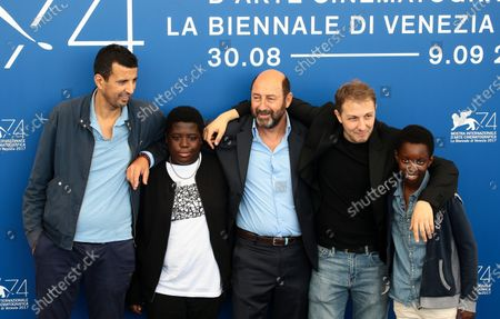 Stock Photo of French actor Samir Guesmi, actor Youssouf Gueye, French actor Kad Merad, director Rachid Hami and Renely Alfred attend 'La Melodie' photocall during the 74th Venice Film Festival
