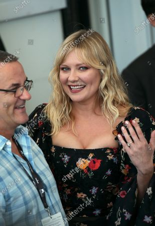 Kirsten Dunst attend the 'Woodshock' photocall during the 74th Venice Film Festival