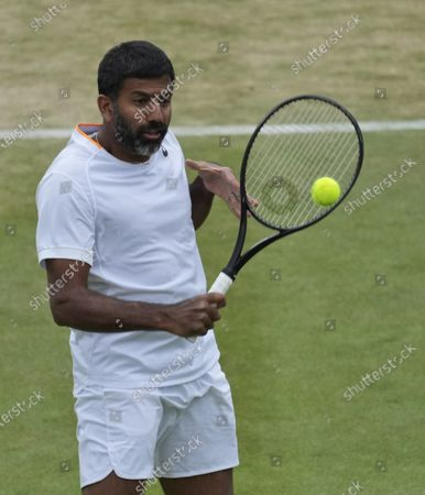 India's Rohan Bopanna plays a return to Jean-Julien Rojer from the Netherlands and Slovenia's Andreja Klepac during the mixed doubles third round match on day eight of the Wimbledon Tennis Championships in London