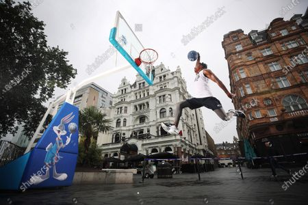 To celebrate the release of Space Jam: A New Legacy in cinemas on 16th July, young basketball players from charitable organisation Who's Got Game and sports presenter Radzi Chinyanganya unveil the new look Bugs Bunny statue in Leicester Square, part of the long-term Scenes in the Square sculpture trail. The dynamic sculpture now includes a life-sized basketball and hoop, along with a decorative floral display in the colours of the Tune Squad, as well as interactive space Jam lenses through a QR code.