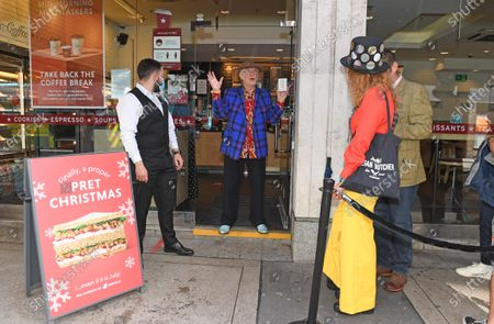 Pret customers queue to be served a Christmas Sandwich by Christmas icon Noddy Holder, to mark the return of the iconic sandwich this July