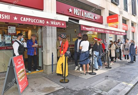 Pret A Manger customers queue to be the first to get a Christmas sandwich, available in shops and for delivery nationwide this July