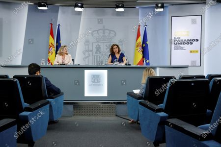 Spanish Treasure Minister and Government's spokeswoman Maria Jesus Montero (R), and Spanish Minister for Economy and Digitalization Nadia Calvino (L) address a press conference after the weekly Cabinet Meeting held at Moncloa Palace in Madrid, Spain, 06 July 2021.
