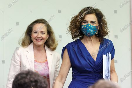 Spanish Treasure Minister and Government's spokeswoman, Maria Jesus Montero (R), and Spanish Minister for Economy and Digitalization Nadia Calvino (L) arrive to the press conference after the weekly Cabinet Meeting held at Moncloa Palace in Madrid, Spain, 06 July 2021.