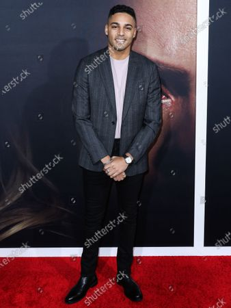 Michael Evans Behling arrives at the Los Angeles Premiere Of Universal Pictures' 'The Invisible Man' held at the TCL Chinese Theatre IMAX on February 24, 2020 in Hollywood, Los Angeles, California, United States.