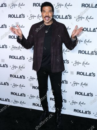 Singer Lionel Richie arrives at Rolla's x Sofia Richie Collection Launch Event held at Harriet's Rooftop at 1 Hotel West Hollywood on February 20, 2020 in West Hollywood, Los Angeles, California, United States.