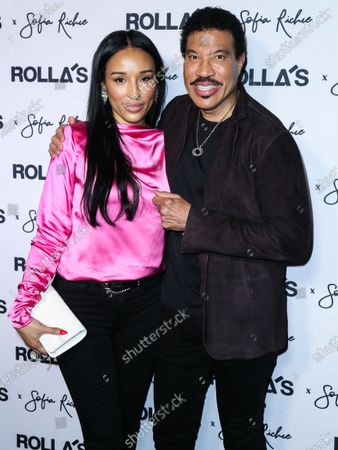 Lisa Parigi and boyfriend/singer Lionel Richie arrive at Rolla's x Sofia Richie Collection Launch Event held at Harriet's Rooftop at 1 Hotel West Hollywood on February 20, 2020 in West Hollywood, Los Angeles, California, United States.