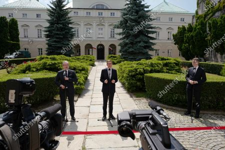 Health Minister Adam Niedzielski (L), Polish Prime Minister Mateusz Morawiecki (C) and government spokesman Piotr Mueller (R) during the press conference after the meeting about the pandemic situation in Poland, in Warsaw, Poland, 06 July 2021.