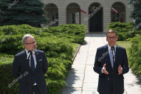 Polish Health Minister Adam Niedzielski (L) and Polish Prime Minister Mateusz Morawiecki (R) during the press conference after the meeting about the pandemic situation in Poland, in Warsaw, Poland, 06 July 2021.