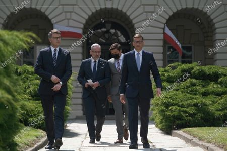 Government spokesman Piotr Mueller (L), Health Minister Adam Niedzielski (2L) and Polish Prime Minister Mateusz Morawiecki (R) during the press conference after the meeting about the pandemic situation in Poland, in Warsaw, Poland, 06 July 2021.