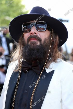 """Sebastien Tellier arrives on the red carpet before the screening of the film """"Annette"""" at the opening of the 74th annual Cannes International Film Festival in Cannes, France on Tuesday, July 6, 2021."""