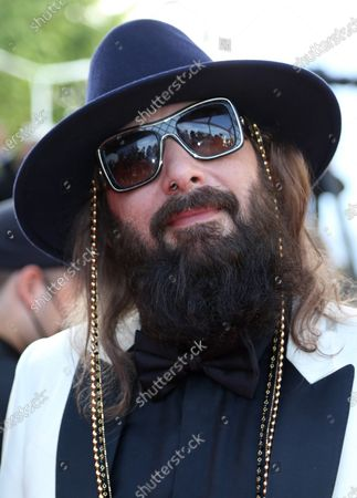 """Stock Photo of Sebastien Tellier arrives on the red carpet before the screening of the film """"Annette"""" at the opening of the 74th annual Cannes International Film Festival in Cannes, France on Tuesday, July 6, 2021."""
