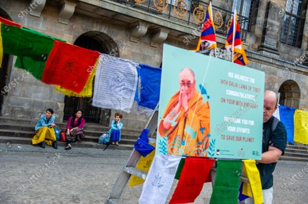 Two Tibetan women are talking while people are putting the finishing touches before the the Dalai Lama 86th birthday celebration started in Amsterdam, on July 6th, 2021.