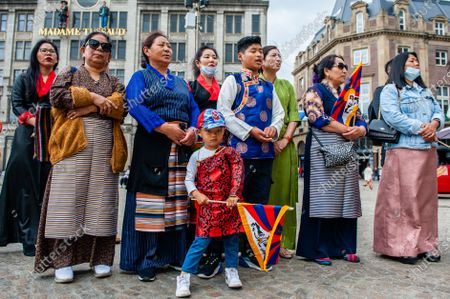 Tibetan people are listening the speeches while holding Tibetan flags, during the Dalai Lama 86th birthday celebration in Amsterdam, on July 6th, 2021.
